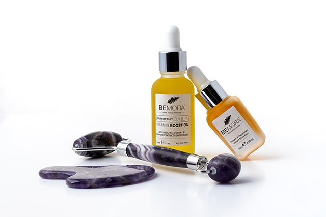 Facial roller with Gua Sha tools and oils
